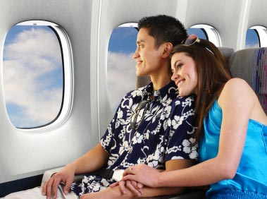 People sitting relaxed in a plane after having hypnosis for fear of flying