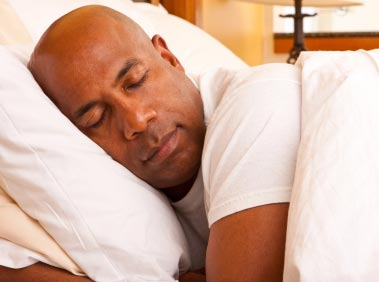 Man sleeping after having hypnosis for insomnia